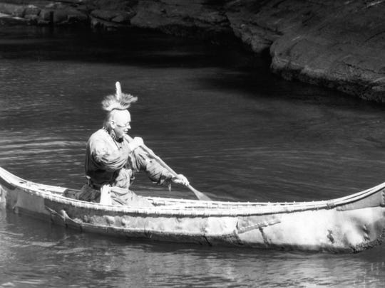 George Larrabee paddles a newly completed 18th century-style bark canoe at Lake Champlain Maritime Museum's Rabble in Arms event in 1999.