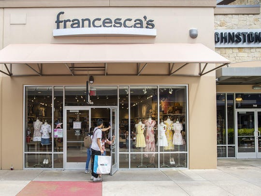 Customers walk into Francesca's at Round Rock Premium Outlets on Frida, May 1, 2020. Retail stores, restaurants, and some movie theaters across Texas are slow to open their doors to 25% capacity after Gov. Gregg Abbott announced his plan to reopen the economy amid the coronavirus pandemic.