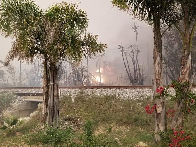 Fire burns near the railroad tracks at Faria Beach