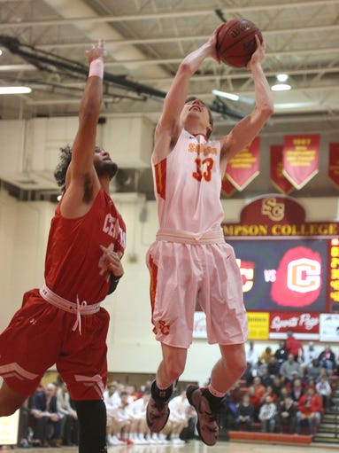 Simpson College's Tyler Stumbo tries to get a shot