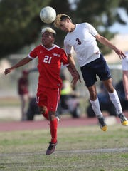 At far right, La Quinta High School's Anthony Ruiz wins possession of the ball against Saul Ayuso of Santa Maria High School at La Quinta. La Quinta's CIF season ended with a 0-1 loss at home.