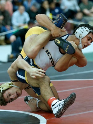 132 Lb Division 1: Victor's Mike Venosa defeated Spencerport's Mason Wersinger during the Wrestling SuperSectionals The College at Brockport on Feb. 11, 2017.