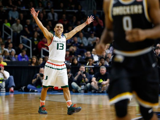 Miami guard Angel Rodriguez celebrates his team's win over Wichita State Shockers in a second round of the 2016 NCAA Tournament at Dunkin Donuts Center.