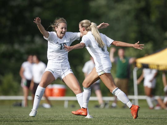 Iowa City West sophomore Rachel Olson, left, celebrates