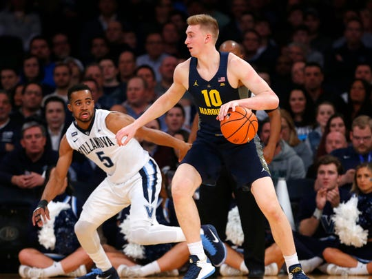 Marquette forward Sam Hauser looks to make his way to the basket while being guarded by Villanova guard Phil Booth on Thursday night.
