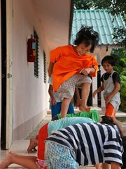 Children play at one of Asia's Hope orphanages. Each home houses 20 orphans who are saved from a life of poverty, human trafficking and underage brothels.