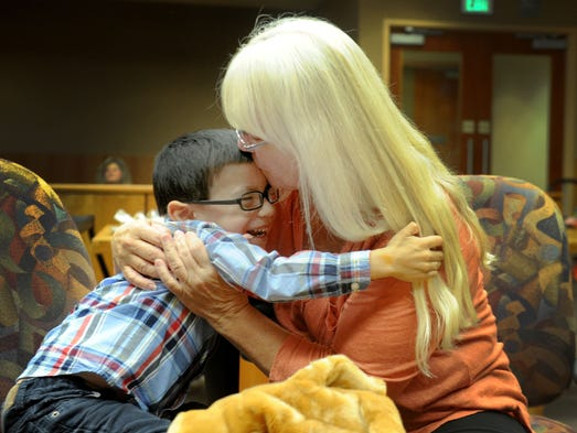 Ventura county families share their adoption joy on happy day sandi chronis of oxnard hugs her son aidan after ccuart Choice Image