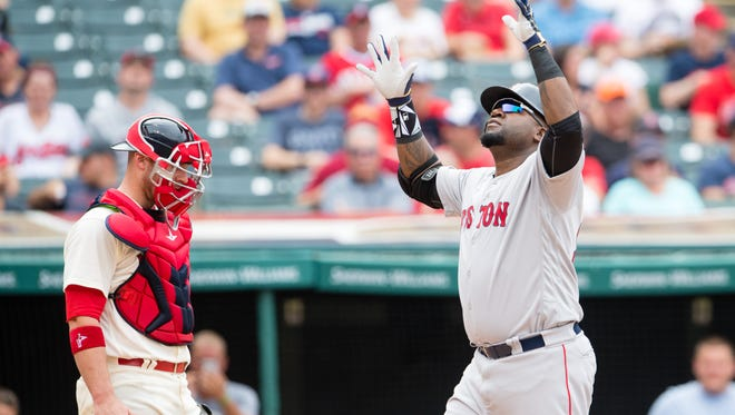 David Ortiz  of the Boston Red Sox celebrates at home after hitting a two-run home run during the sixth inning.