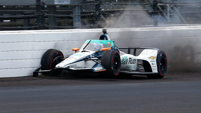 The car driven by Fernando Alonso, of Spain, hits the wall in the fourth turn during practice for the Indianapolis 500 auto race at Indianapolis Motor Speedway in Indianapolis, Thursday, Aug. 13, 2020.