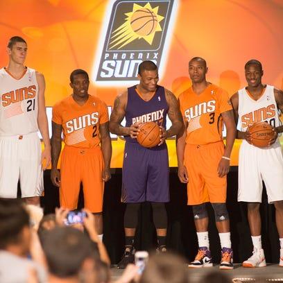 Suns players (from left) Alex Len, Eric Bledsoe, P.J.