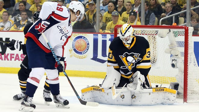 Penguins goalie Matt Murray makes a save in front of Capitals center Nicklas Backstrom during the second period.