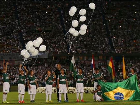 Children release balloons during a tribute to members of Brazil's Chapecoense soccer team who died in a plane crash, at Atanasio Girardot stadium where they were to play a game in Medellin, Colombia, Wednesday, Nov. 30, 2016. Brazil's team was traveling to Colombia to meet up with Atletico Nacional on Wednesday night for the Copa Sudamericana final.
