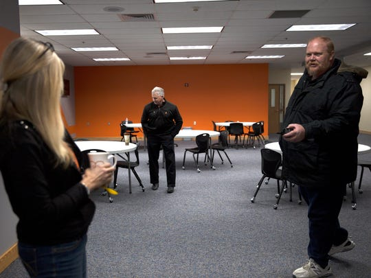 Transition coordinator Cammie LePlatt, left, Superintendent Kirk Carpenter and Principal Warman Hall talk on Friday in the new commons at Aztec High School.