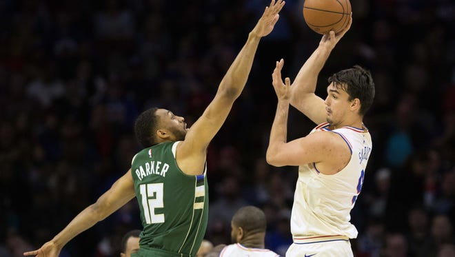 Jabari Parker of the Bucks tries to disrupt 76ers forward Dario Saric as he passes off to a teammate on Wednesday night.
