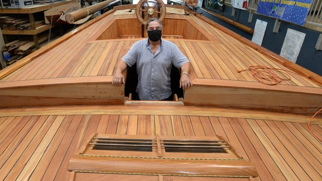 Bayfront Maritime Center Executive Director Rich Eisenberg is shown Thursday onboard the Porcupine, a historical representation of a War of 1812 schooner that is being built at the center.
