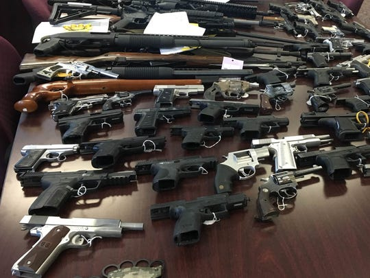 Dearborn police display 200 guns they say were confiscated during the past 6 months.