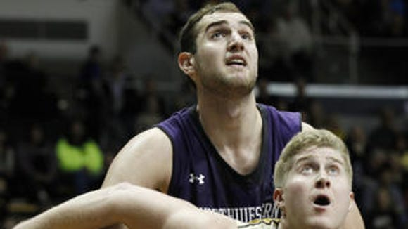 Former Purdue center Travis Carroll has begun his collegiate coaching career as a volunteer assistant with the University of Indianapolis.