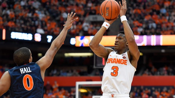 Andrew White, shown shooting a jumper in Saturday's 66-62 win over  Virginia, has scored 20 or more points in each of the Orange's last four wins and is 15-for-36 from 3-point range. (41 percent).