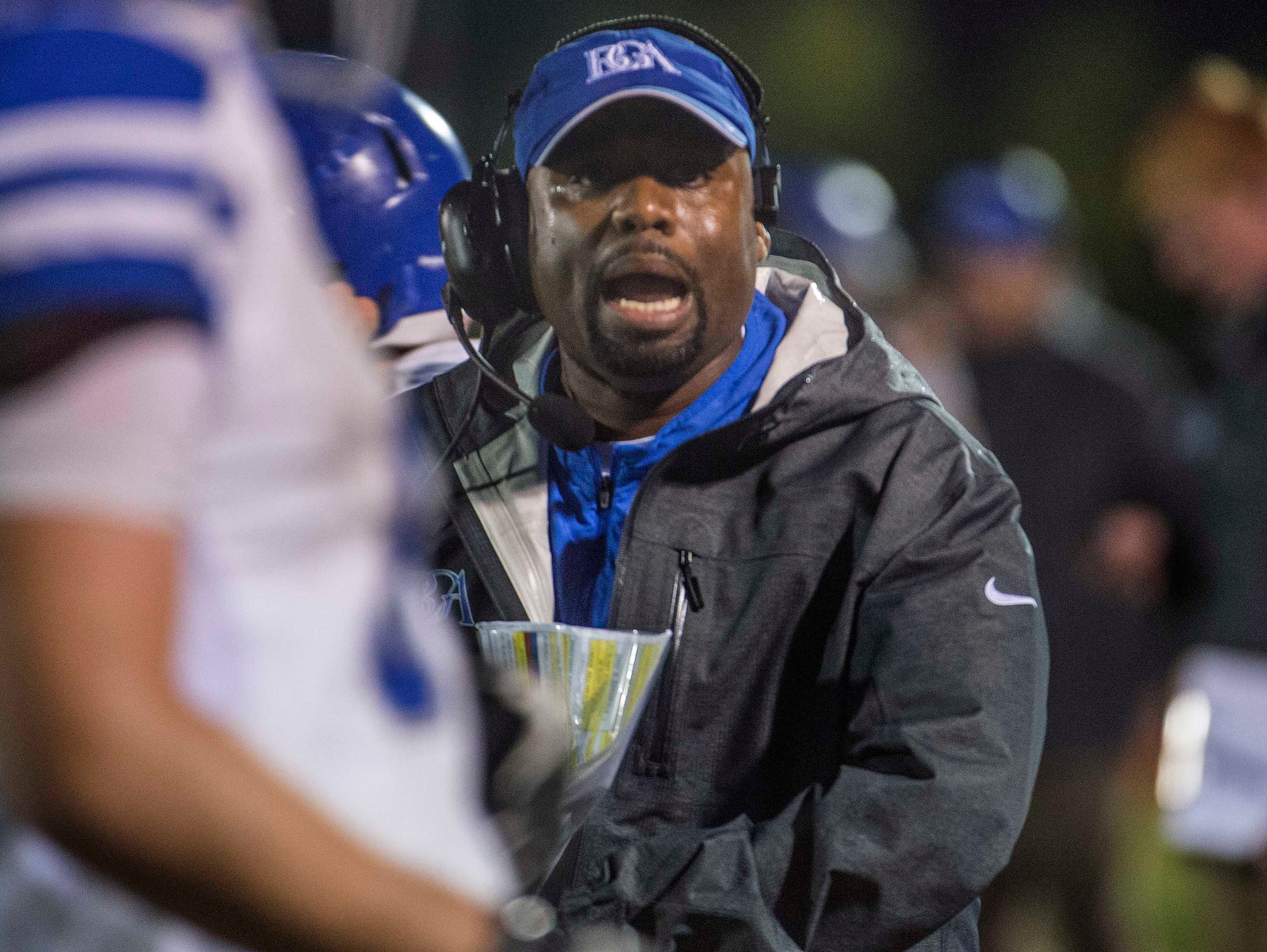BGA coach Roc Batten encourages his team in the final seconds of overtime at Page High School on Friday.