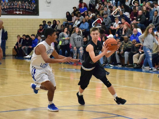 Wilson Memorial's Garrick Welch moves toward the basket