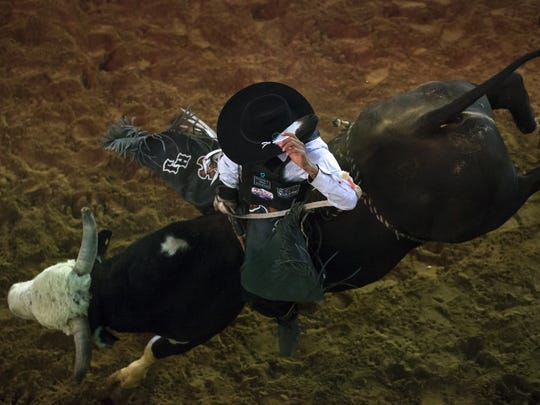 Hernal John hangs on to Dirty Harry, the bull drawn for him in the 15th Annual Kenny Young Bull Riding Classic in Page. John rode the full eight seconds and scored 67.