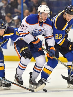 Top overall draft pick Connor McDavid (97) had two shots and no points in his NHL debut.