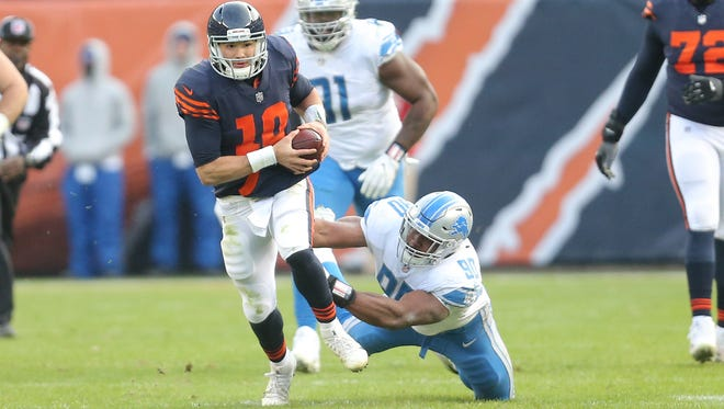 Mitchell Trubisky runs out of the grasp of Detroit Lions defensive end Cornelius Washington during the second half at Soldier Field on Nov. 19.