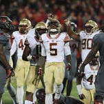 Florida State's Reggie Northrup (5) celebrates as the Seminoles stop the Cardinals on downs on Thursday at Papa John's Cardinal Stadium. (By David Lee Hartlage, Special to the C-J) Oct. 30, 2014.