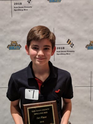 Rhys Triplett, a seventh-grader at Hermosa Middle School, poses with his first-place plaque after winning the San Juan County Spelling Bee on Monday in Bloomfield.