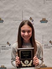 Heights Middle School seventh-grader Sierra Johnson poses with her second-place plaque after the San Juan County Spelling Bee on Monday in Bloomfield.