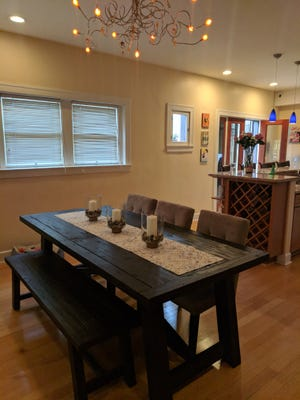 The dining area in the Lamar home backs up to French doors that open to the backyard, and sits between the family room and kitchen area.