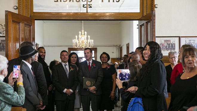 Mayor Robert Sullivan, center, with city councilors Rita Mendes and Tina Cardoso to his left and right.