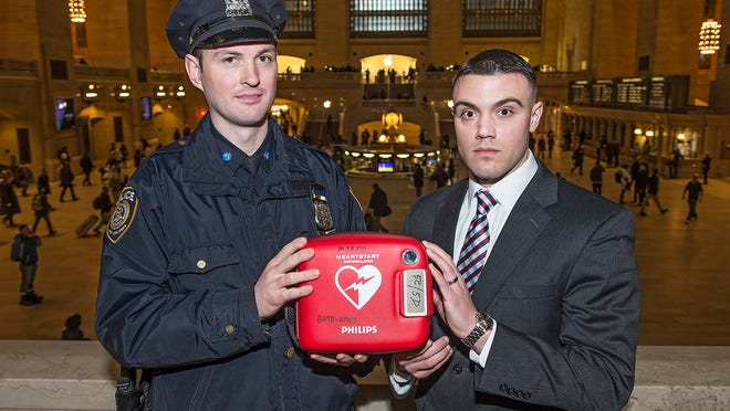 MTA Police Officer Michael Burns, left, and Putnam Valley volunteer Firefighter Francis Rush helped revive a man who went into cardiac arrest in Grand Central Terminal on Jan. 23. Burns, who lives in Nyack, ran to the scene with a defibrillator and Rush performed chest compressions.
