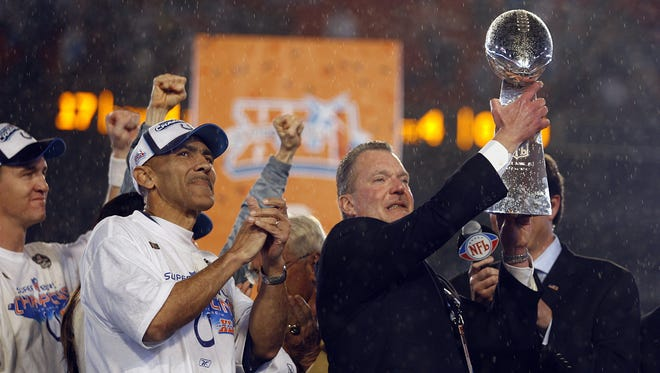 Indianapolis Colts versus the Chicago Bears in Super Bowl XLI on February 4, 2007 at Dolphins Stadium in Miami, Fla.  (Matt Kryger / The Indianapolis Star)  Colts owner Jim Irsay,right, raises the Vince Lombardi Trophy as head coach Tony Dungy and Peyton Manning look on following the Colts 29-17 win in Super Bowl XLI. <b>02/07/2010 - D12 - SPECIAL - 1ST - THE INDIANAPOLIS STAR</b><br />The first time: Team owner Jim Irsay holds up the Vince Lombardi Trophy after the Colts' Super Bowl XLI victory, held in the same stadium as tonight's game.