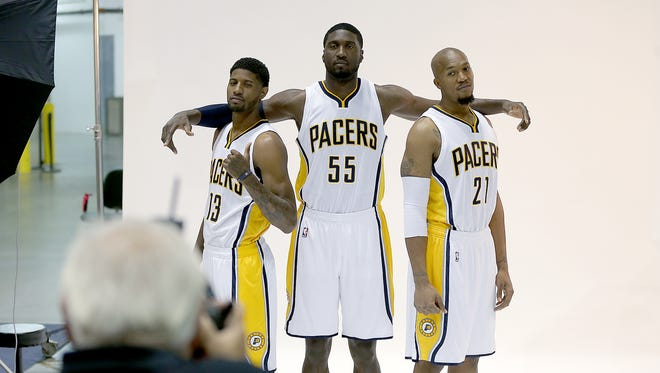 The Indiana Pacers held their media day Monday, September 29, 2014, morning at Bankers Life Fieldhouse. Here Pacers Paul George,left, Roy Hibbert and David West,right, pose for a photo.