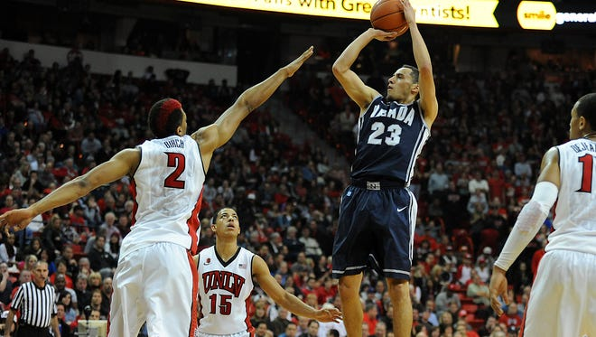 Jan 8, 2014: Wolf Pack guard Michael Perez (23) shoots against the defense of UNLV Runnin' Rebels forward Khem Birch (2) during an NCAA men's basketball game at Thomas & Mack Center. Reno won the game 74-71.
