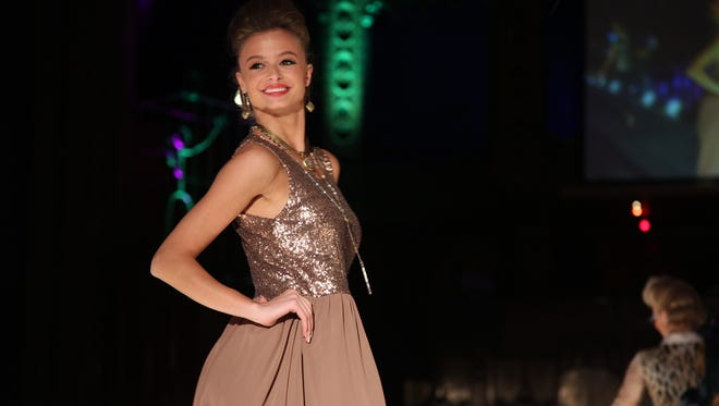 Models show fashions from B. Younique with Reed Eye Associates' collection at Rochester Fashion Week's Fashion of Franklin on Saturday Night. (Jennifer Waldow)