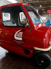 A 1964 Peel P-50 microcar replica is on display at