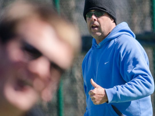 Warlassies tennis coach Chris Barcklow runs the boys