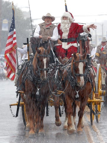 Santa Claus hitched a rainy ride on the El Paso Sheriff's