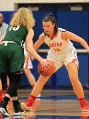 Canton's Madison Wolfbauer (right) gets in a defensive