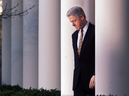 President Bill Clinton walks to the podium to deliver a short statement on the impeachment inquiry in the Rose Garden of the White House in Washington Friday, Dec. 11, 1998.  Nearing a showdown over the fate of his presidency, President Clinton apologized to the country today for his conduct in the Monica Lewinsky affair and said he would accept a congressional censure or rebuke.