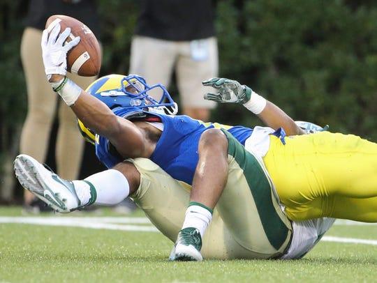 Delaware defensive back Nasir Adderley holds onto the