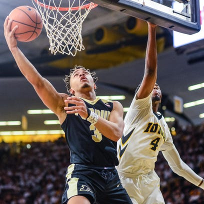 Purdue guard Carsen Edwards (3) goes to the basket