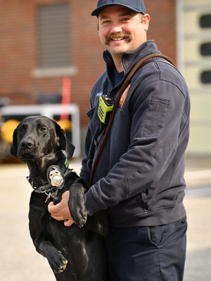 Firefighter/EMT Matt Ethier has trained a Black Lab, Riggs, to work with him and the Auburn department. Riggs demonstrated his skills on Tuesday.