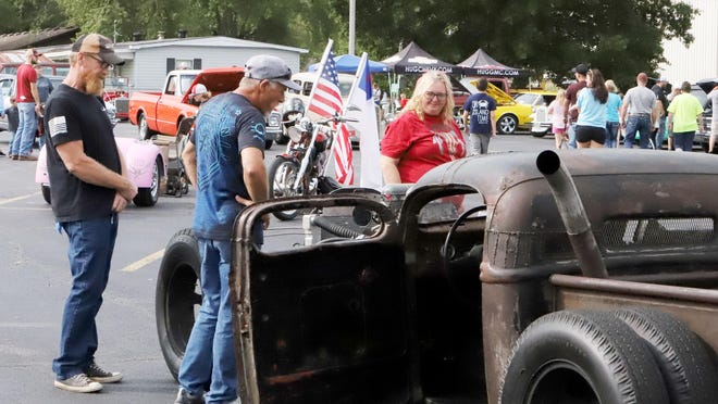 """Freddie Johnson, from left, Gary Plymale and Pattie Johnson check out Larry Bowen's 1946 """"Fordolet,"""" a mash up of both iconic brands, entered in the Hiller family benefit car show, Saturday, Sept. 12, in Lavaca."""