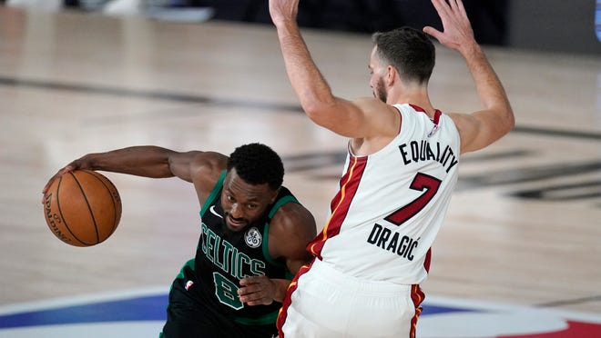 The Celtics' Kemba Walker tries to get around the Heat's Goran Dragic (7) during the second half Tuesday night.