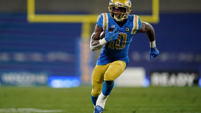 UCLA running back Demetric Felton runs for a touchdown during the second quarter of a game against USC, Saturday, Dec 12, 2020, in Pasadena, Calif. (AP Photo/Ashley Landis)
