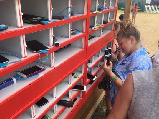 Cell phone charging stations are set up at various