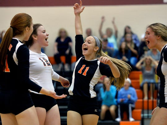 From left, Central York's Emma Saxton, Laura Fahs, Hannah Rishel and Natalie Hawksworth celebrate at the end of the fifth game of a YAIAA girls volleyball match Wednesday, Sept. 23, 2015, at Central York. Central York defeated Red Lion 3-2 (25-17, 18-25, 23-25, 25-16, 16-14). Chris Dunn Ñ Daily Record/Sunday News